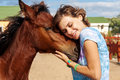 Portrait of young girl with a foal on the farm Royalty Free Stock Photography