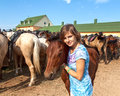 Portrait of young girl with a foal on the farm Royalty Free Stock Images