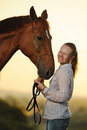 Portrait of young girl with horse at the sunset Royalty Free Stock Photo