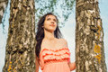 Portrait of a young girl in a park forest with birch trees Royalty Free Stock Photo