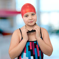 Portrait of a young girl in a red cap at the pool athlete swimmer square frame Stock Photography
