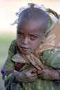 Portrait of a young girl at work water fetching ethiopian with jug on her back in rural ethiopia children have to walk many miles Stock Image