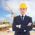 Portrait of young handsome business man in builder s helmet yellow Stock Photos