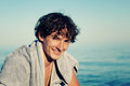 Portrait of young handsome man on the beach healthy drying hair after swimming in ocean Royalty Free Stock Images