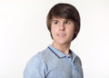Portrait of young handsome man, teenage boy isolated on studio w Royalty Free Stock Photo