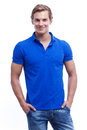 Portrait of a young handsome man wearing blue t-short isolated o Royalty Free Stock Photo
