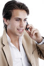 Portrait of a young handsome playboy on the phone smiling talking mobile white background Royalty Free Stock Photo