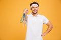 Portrait of a young handsome sportsman holding skipping rope Royalty Free Stock Photo