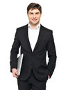 Portrait of young happy businessman holds laptop Royalty Free Stock Photos