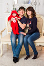 Portrait of a young happy family with the kid at home Royalty Free Stock Photo