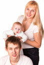 Portrait of a young happy family: mother, father and baby smiling Stock Image