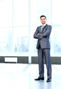 Portrait of young happy smiling cheerful business man full body Stock Photo