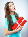 Portrait of young happy smiling woman hold red gift box. Isolat Stock Photos
