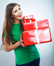 Portrait of young happy smiling woman hold red gift box. Isolat Stock Images