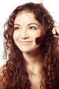 Portrait of young happy smiling woman with make up tools Stock Image