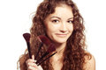Portrait of young happy smiling woman with make up tools Royalty Free Stock Photography