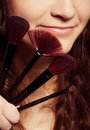 Portrait of young happy smiling woman with make up tools Royalty Free Stock Photos