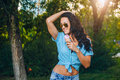 Portrait of young happy woman eating ice cream Royalty Free Stock Photo