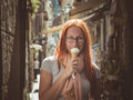 Portrait of young happy woman eating ice-cream, outdoor, Sorento, Italy Royalty Free Stock Photo