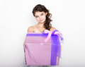 Portrait of young happy woman with gift box in hands Royalty Free Stock Photo