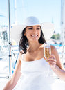 Portrait of a young and happy woman holding champagne Royalty Free Stock Photo