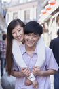 Portrait of young heterosexual couple embracing outdoors in beijing Stock Photo