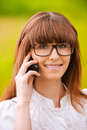 Portrait of young lady with phone Royalty Free Stock Images