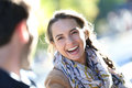 Portrait of young laughing woman with her boyfriend cheerful girl pulling by arm in central park Royalty Free Stock Photos