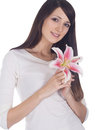 Portrait of young lovely brunette with flower in hands Royalty Free Stock Photo