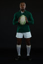 Portrait of young male rugby player holding ball Royalty Free Stock Photo