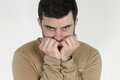 Portrait of a young man anxious over white background Royalty Free Stock Photography