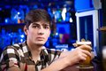 Portrait of a young man at the bar spending time in nightclub Stock Images