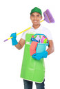 Portrait of young man with cleaning equipment isolated over white background Royalty Free Stock Images