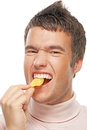 Portrait of young man eating chips Royalty Free Stock Photo