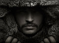 Portrait of a young man in fur hood guy Stock Photography