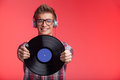 Portrait of young man holding disk and wearing headphones. Royalty Free Stock Photo
