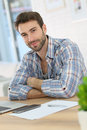 Portrait of a young man at home working on his laptop Royalty Free Stock Photo