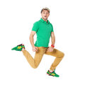 Portrait of young man jumping in studio isolated on white. Royalty Free Stock Photo