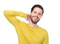 Portrait of a young man laughing with hand in hair close up Royalty Free Stock Image