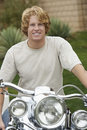 Portrait Of Young Man On Motorbike Stock Photos