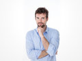 Portrait of young man resting chin guy on casual clothes with fist on his goatee Royalty Free Stock Photo
