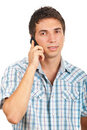 Portrait of young man speaking by phone Royalty Free Stock Photos