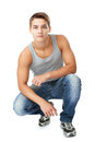Portrait of young man squatting Royalty Free Stock Photo
