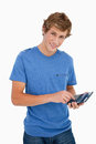 Portrait of a young man using a calculator Royalty Free Stock Images