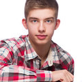 Portrait of a young man he is wearing checkered pattern shirt isolated Stock Photo