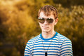 Portrait of young man wearing sunglasses Royalty Free Stock Image