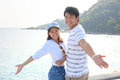 Portrait of young man and woman relaxing and happy emotion on se men women sea side use for people relax feel free vacation go to Royalty Free Stock Images
