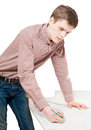 Portrait of young man working on blueprints Royalty Free Stock Photo
