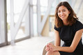 Portrait of young mixed race Asian businesswoman sitting Royalty Free Stock Photo