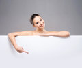 Portrait of a young and naked Caucasian woman with a banner Royalty Free Stock Photo